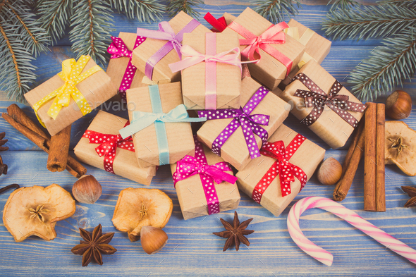 Vintage photo, Wrapped gifts with ribbons for Christmas, spices and spruce branches - Stock Photo - Images