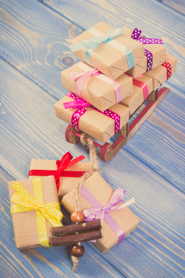 Vintage photo, Wooden sled and wrapped gifts with ribbons for Christmas or other celebration - Stock Photo - Images