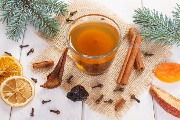 Spruce branches and traditional compote of dried fruits for Christmas - Stock Photo - Images