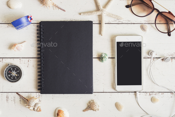 Blank notebook and cellphone with various shell - Stock Photo - Images