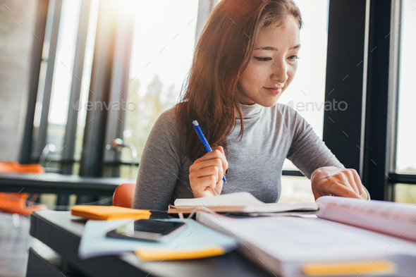 University student preparing for final exams - Stock Photo - Images
