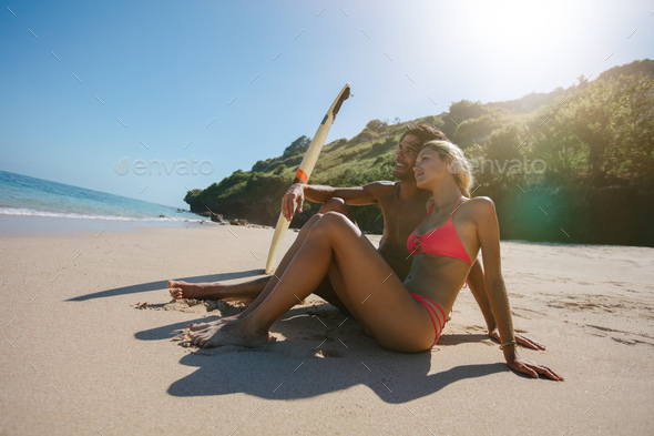 Young couple enjoying romantic beach holidays - Stock Photo - Images