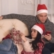 Couple in Love at Christmas Relaxing in Flat.