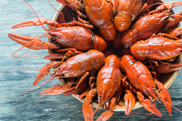 Bowl of boiled crayfish on the wooden table - Stock Photo - Images