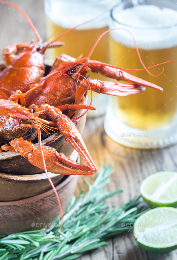 Bowl of boiled crayfish with two mugs of beer - Stock Photo - Images