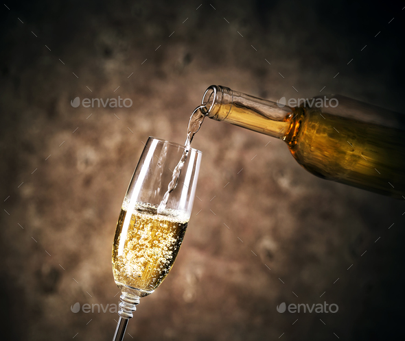 White wine pouring into a glass - Stock Photo - Images