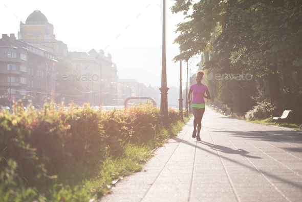 african american woman jogging in the city - Stock Photo - Images