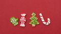 Four Christmas cookies on a red background - PhotoDune Item for Sale
