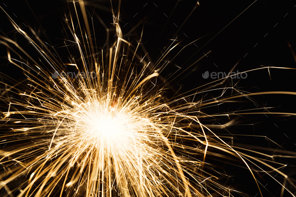 New year party sparkler closeup on black background - Stock Photo - Images