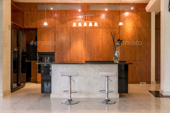 Kitchen surrounded by wooden cabinets - Stock Photo - Images