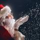 Download Santa Claus blows snow. from PhotoDune