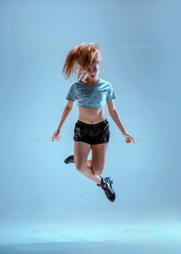 Attractive girl dancing twerk in the studio - Stock Photo - Images