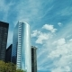Two Modern Office Buildings Against the Sky and Clouds Drifting Fast. The Business District of - VideoHive Item for Sale