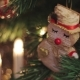 Christmas Snowman Toy on the Christmas Tree in Front, Red Toy Swinging in Back - VideoHive Item for Sale