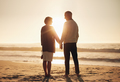 Senior couple standing on a beach together