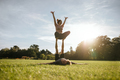 Fit couple exercising acroyoga in park