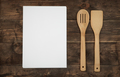Wooden kitchenware and blank paper sheets for recipes