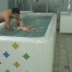 The Man Bathing the Little Baby in the Child Pool - VideoHive Item for Sale