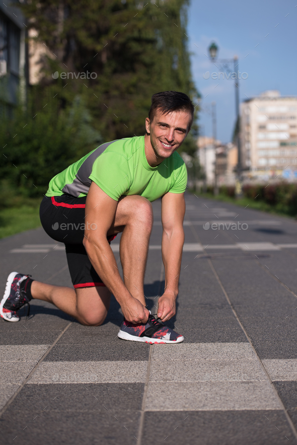 Young athlete, runner tie shoelaces in shoes - Stock Photo - Images