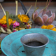 Religious offerings in Bali, colored flowers with turquoise dish - PhotoDune Item for Sale