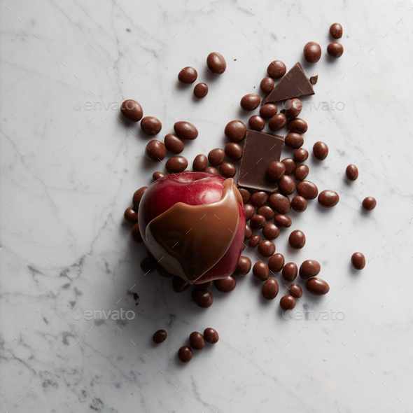 Chocolate on red apple fruit - Stock Photo - Images