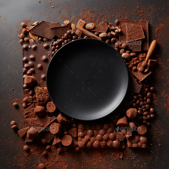 frame of chocolates with plate - Stock Photo - Images