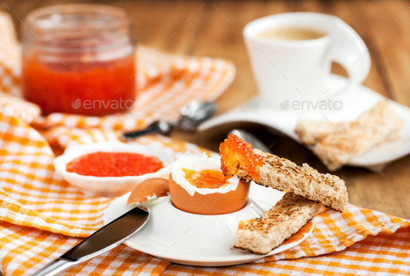 Boiled egg with red caviar, toast and coffee - Stock Photo - Images
