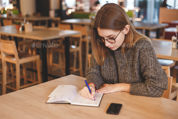 Young freelancer girl working in the creative office. Modern workplace concept. - Stock Photo - Images