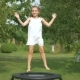 Little Girl Jumping on Trampoline in Garden - VideoHive Item for Sale