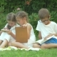 The Children Sitting on the Grass in the Garden - VideoHive Item for Sale