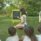The Woman Teaches the Kids in the Garden - VideoHive Item for Sale