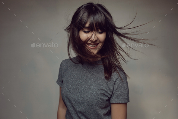 Pretty brunette woman posing in light room - Stock Photo - Images