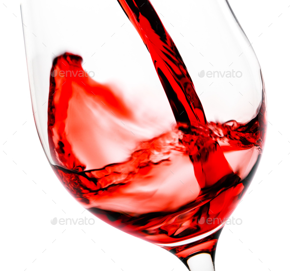 Red wine pouring in the glass goblet - Stock Photo - Images