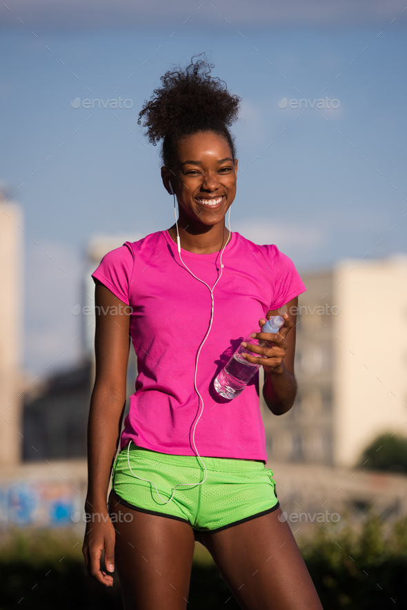 african american woman running outdoors - Stock Photo - Images