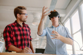 Young men testing virtual reality goggles