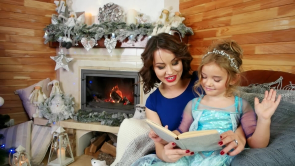 Mother and Daughter Read a Book, Family Reading a Christmas Story ...