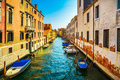 Venice cityscape, water canal, bridge and traditional old buildi