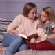 Mother and Daughter Reading Story at Home Together - VideoHive Item for Sale