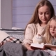 Mother and Daughter Reading Bedtime Story on Sofa - VideoHive Item for Sale