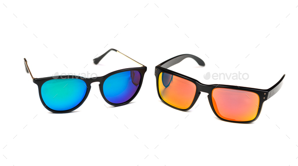 Two sunglasses, blue and yellow lens. - Stock Photo - Images