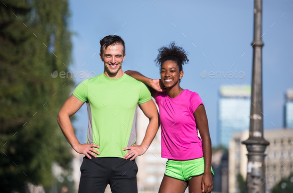 portrait of young multietnic jogging couple ready to run - Stock Photo - Images