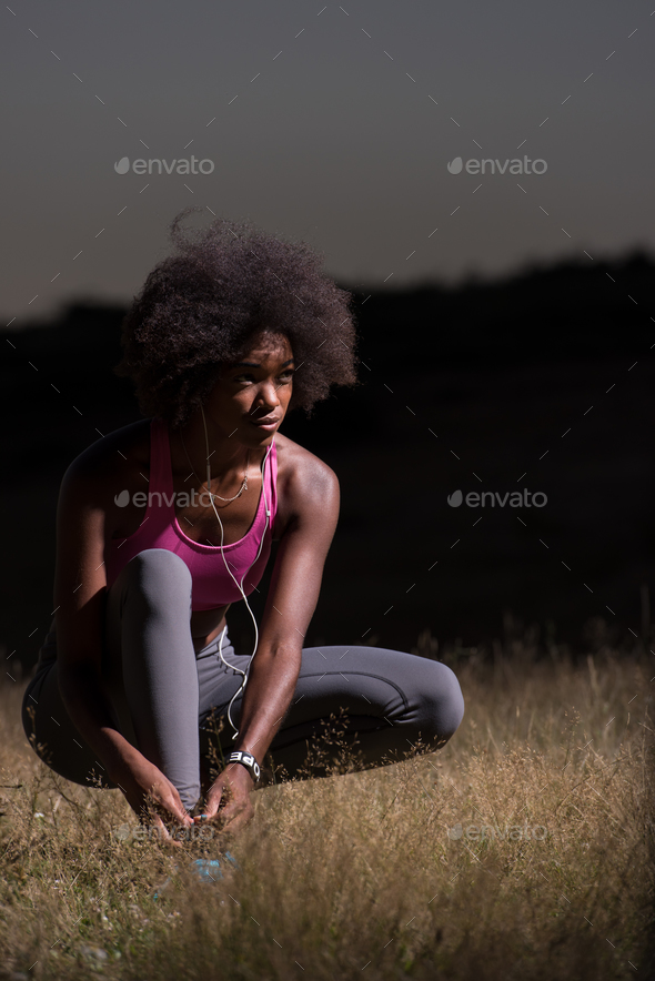 black woman runner tightening shoe lace - Stock Photo - Images