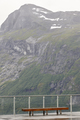 Norwegian mountain viewpoint with bench. Travel Norway. Vertical