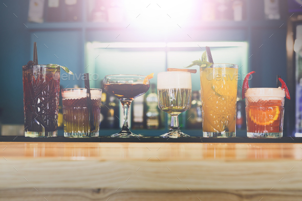 Creative alcohol cocktails in night club bar - Stock Photo - Images