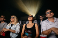Young people watching 3d movie in theater - PhotoDune Item for Sale