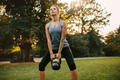 Strong young woman exercising with kettlebell - PhotoDune Item for Sale