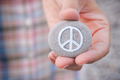 Person holds stone with peace symbol - PhotoDune Item for Sale