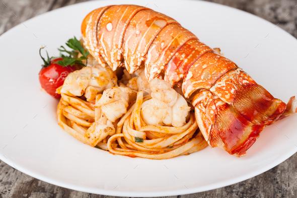 Lobster spaghetti, Italian cuisine - Stock Photo - Images
