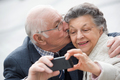 old couple taking a self portrait - PhotoDune Item for Sale