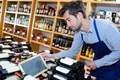 wine seller man tidying up bottles